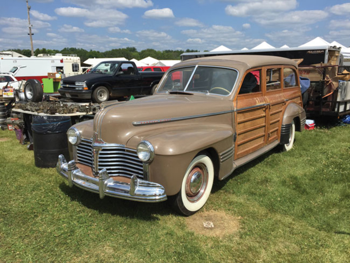 Like many clubs, the National Woodie Club set up a booth in the swap meet of the Iola Old Car Show and used this 1941 Pontiac to draw attention to its display.