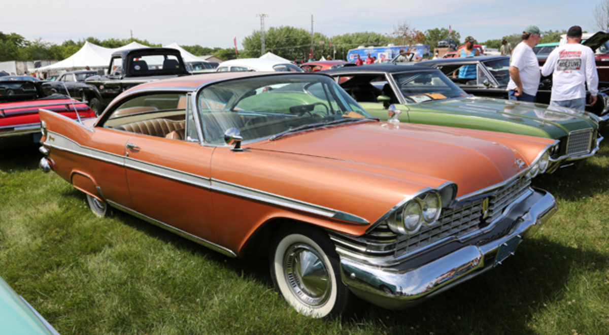 Finned MoPars are big, especially at the Iola Old Car Show, and adding its part to the fin fun at IOLA '14 was John Zastrow's glowing gold 1959 Plymouth Sport Fury two-door hardtop with several '50s goodies, such as skirts, twin rear antennae and dual mirrors.