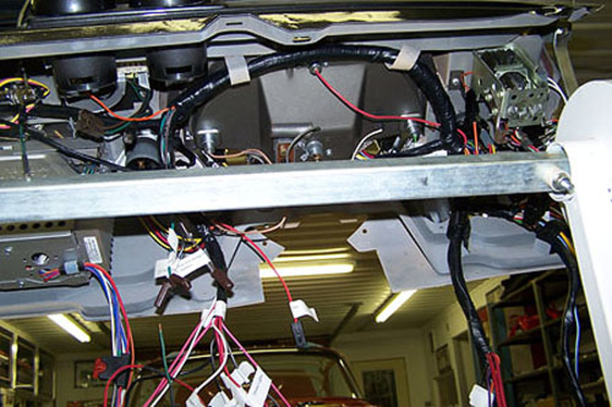 By installing the wiring while the instrument panel is out of the car, the wires can be more easily accessed from behind. Using this rotating body shop fender stand also makes the process much easier.