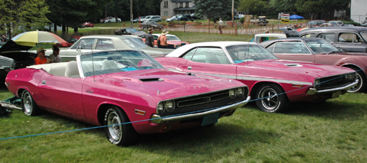 A pair of Panther Pink Challengers graced this year's Iola Old Car Show Blue Ribbon Concours in coupe and convertible forms.