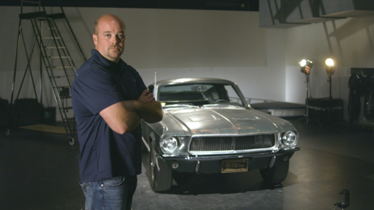 Sean Kiernan and the Bullitt Mustang. Photo - David Newhardt - Mecum Auctions