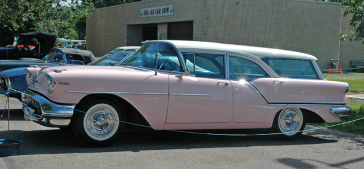 Looking pretty in pink, this 1957 Oldsmobile Golden Rocket 88 Fiesta station wagon also sported a white roof. This pillared version with sedan door frames was the rarest Olds station wagon in 1957 with just 5,052 built.