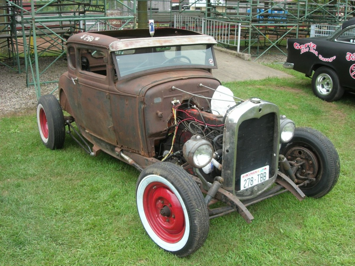 """Rat rods"" come in all flavors, such as this Chevy six-cylinder-powered, Ford five-window coupe-bodied merger that's topped with a beer-tap shift handle."