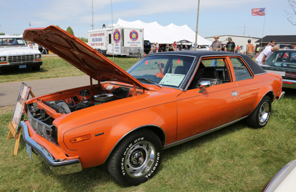 AMC is well-represented at the Iola Old Car Show, as a Wisconsin-based show should be. Among the many American Motors products at IOLA '14 was Robert E. Wunrow's orange 1976 Hornet two-door sedan with a 304-cid V-8, which made it one of only 789 built by the factory that way.