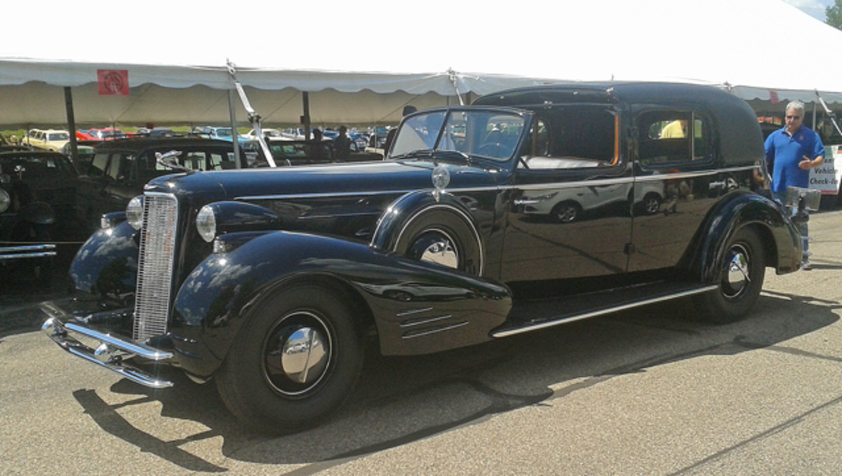 """Dave Mitchell's outstanding 1934 Cadillac Series 452-C Fleetwood Town Cabriolet is pictured upon its arrival in the """"Four for All in '14"""" theme tent. The car is largely original with only rechromed bumpers, select exterior repainting and a new roof covering."""