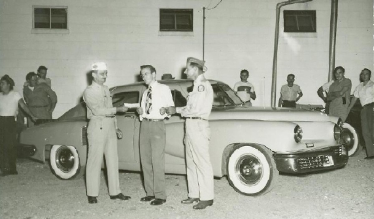 Schroeder receives the keys to the 1948 Tucker in September 1949.