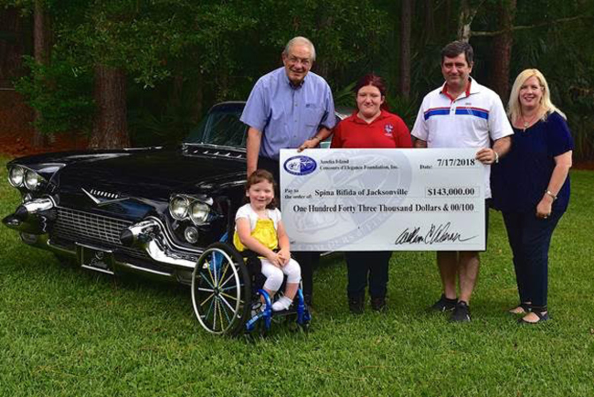 The Amelia's Founder and Chairman, Bill Warner (top left), and Executive Director, Brian Webber (second from right), present the Executive Director of Spina Bifida of Jacksonville, Demery Webber (far right), with a check for $143,000.