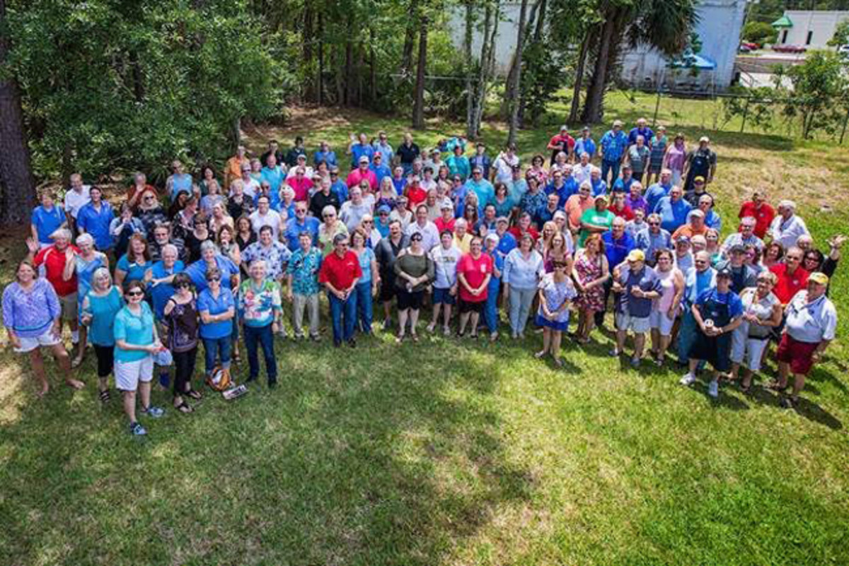 A small group of the event's more than 600 volunteers gather for a photo. The Amelia would not be possible without their faithful support.