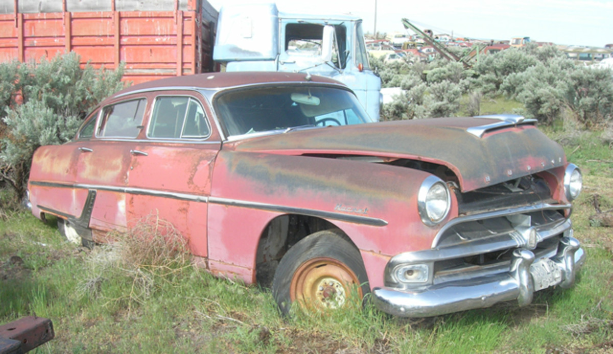 "Sporting the new-for-1954 one-piece windshield, this Hudson Hornet sedan lacks only a buyer and some ""TLC"" to put it back on the road."