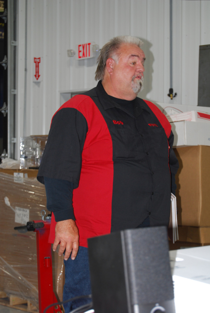 Bob Doremire of the Wisconsin Specialty Vehicle Alliance spoke at Greg's Speed Shop in Waupaca, Wis.