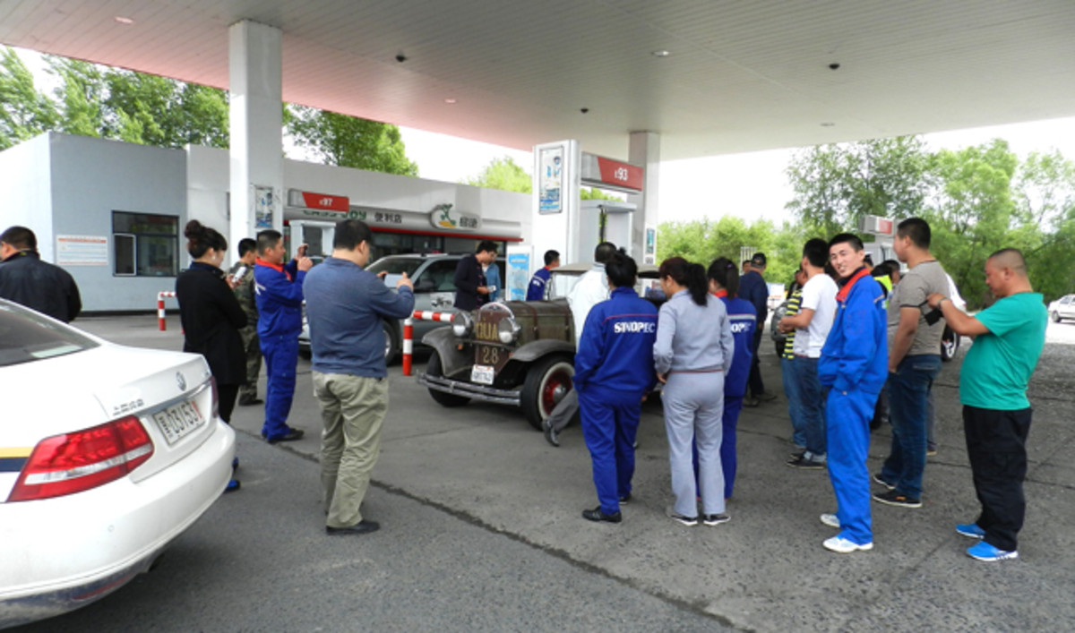 The 1928 Plymouth attracts attention in Japan.