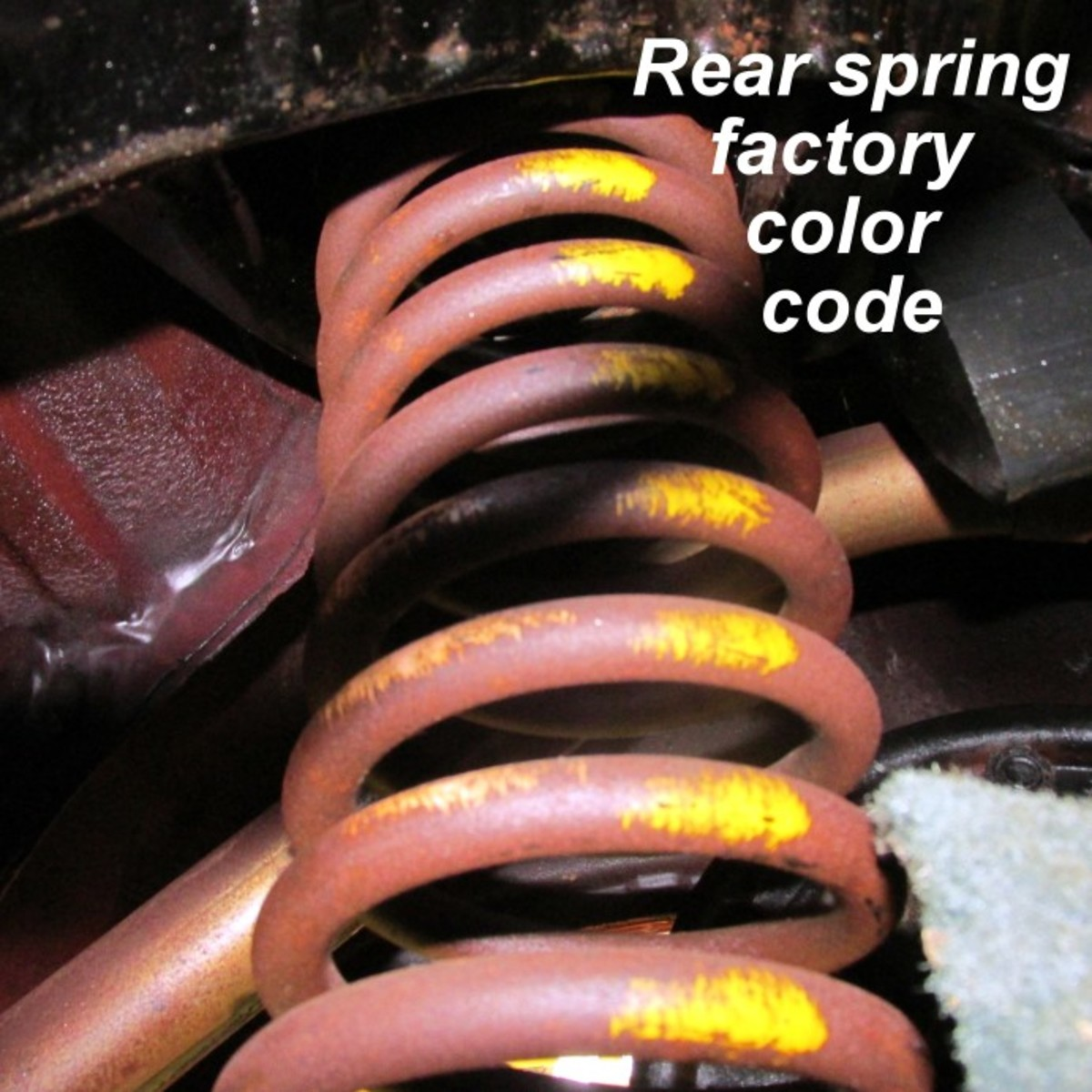 A yellow stripe marks the rear springs of the 1963 Impala.