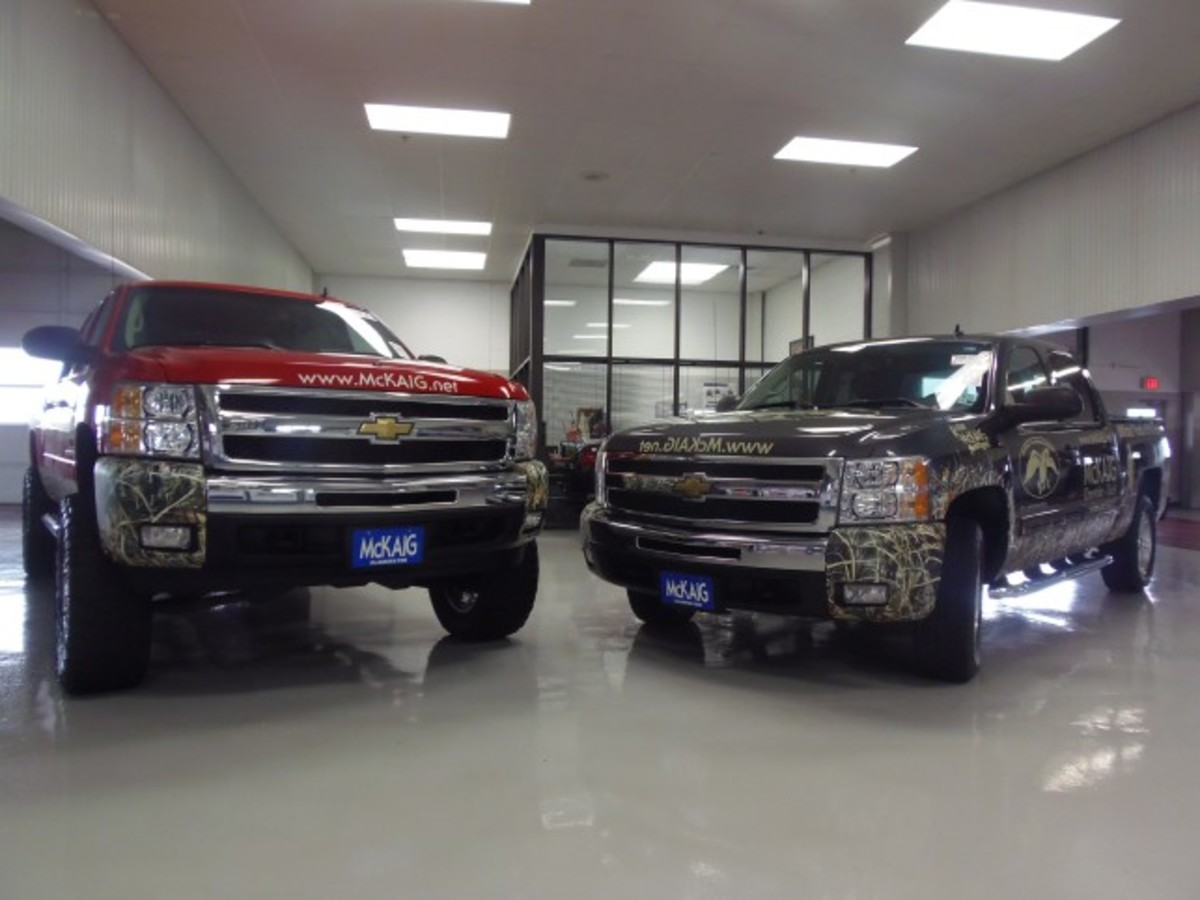 "The 2011 and 2010 Chevrolet Z71 pickup trucks of Phil and Willie Robertson from ""Duck Dynasty"" will be auctioned for charity Oct. 23."