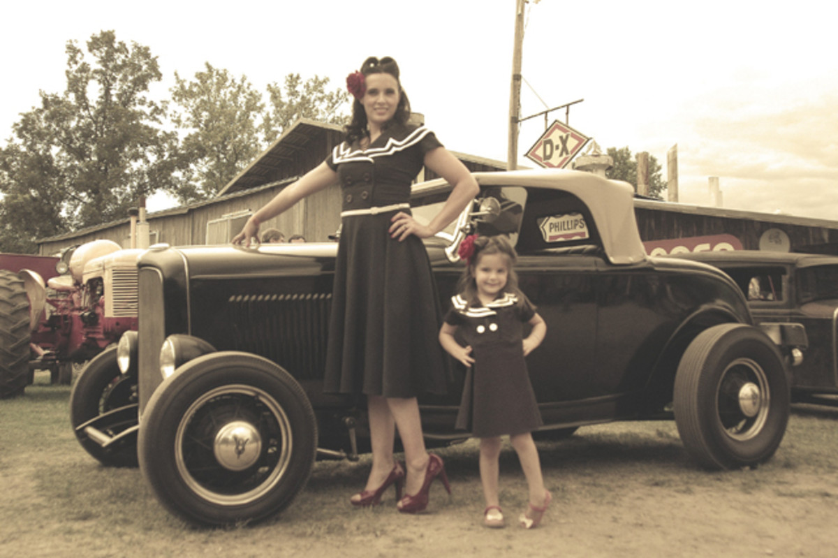 Pinup model Bekki LaBine and daughter Amelia pose with the mysterious 1940s-built 1932 Ford roadster at Symco.