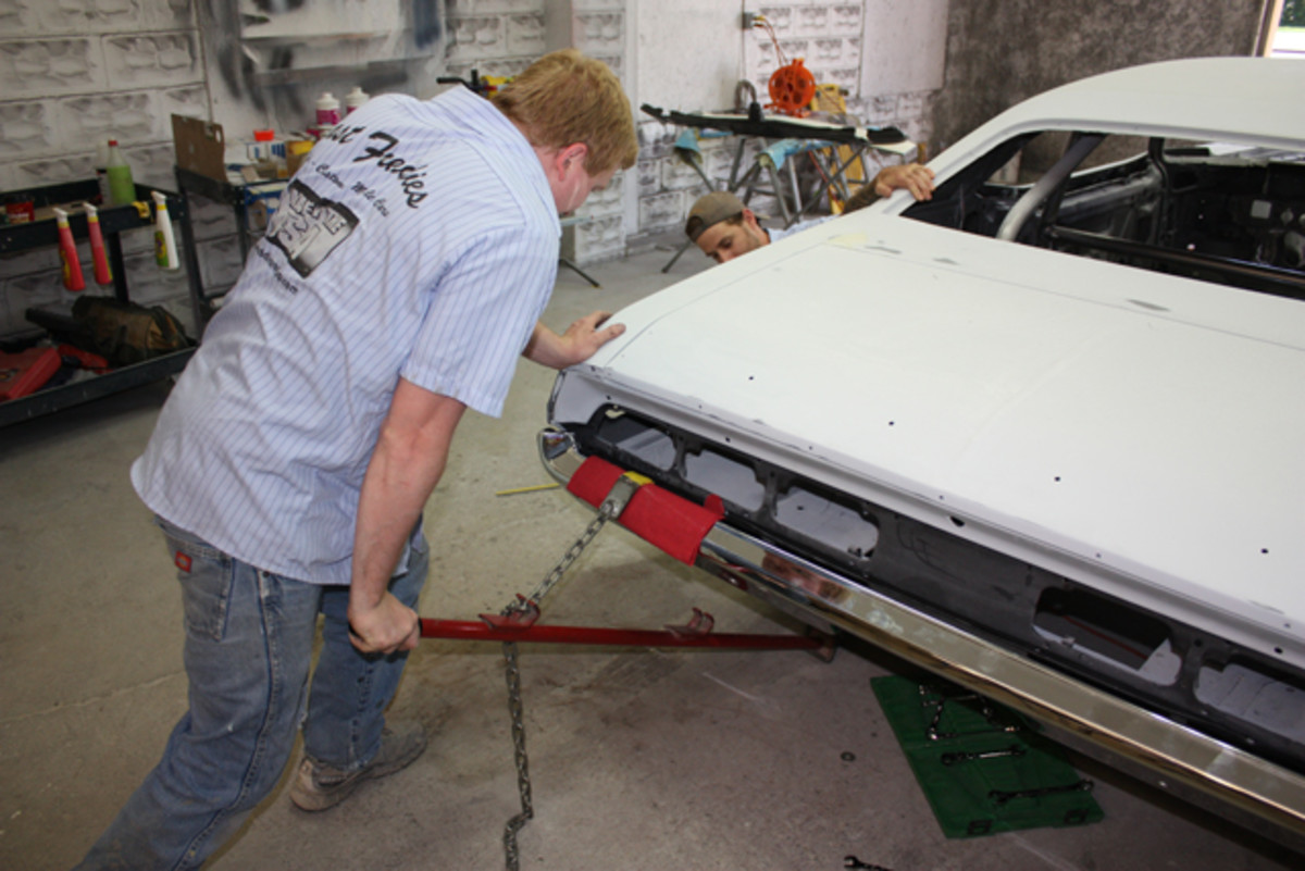 """When all else fails, brute force is sometimes needed. In this case, Branson employs a """"Pogo Stick"""" leverage tool to pull the Challenger's bumper down just slightly on the driver's side."""