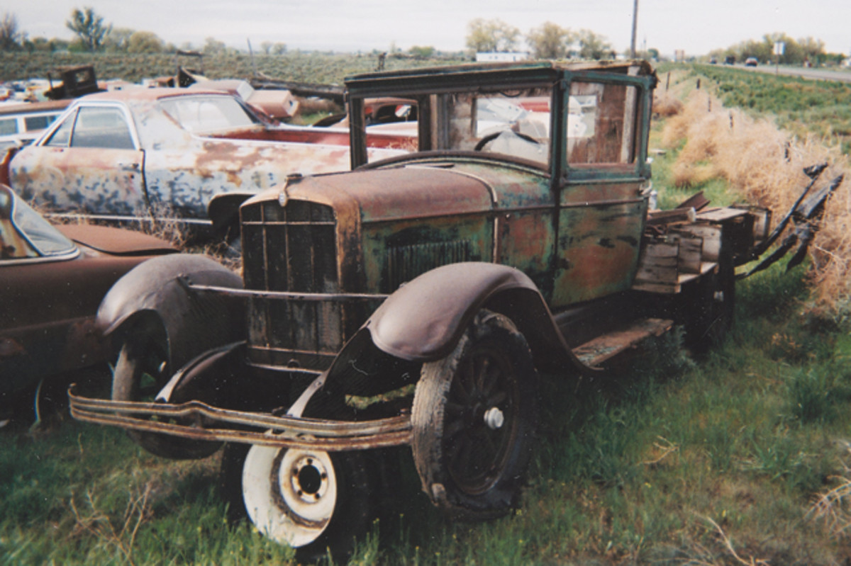 A former sedan converted to a flatbed truck, this rare Durant Model 2 retains most of its hard-to-find components from the cowl forward. It's parked at the entrance and acts as a draw, visible to passersby on Highway 46, which fronts the salvage yard.