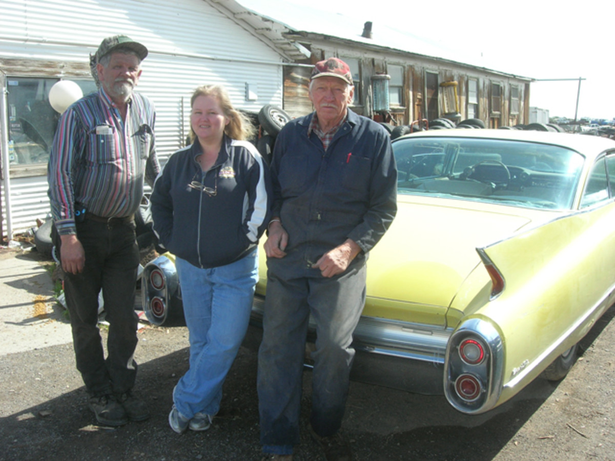 L&L Classic Auto staff includes (l-to-r) yard manager Ron Ewing, bookkeeper Bobby Coleman and owner Larry Harms. They're posing with a 1960 Cadillac Coupe deVille, a recent addition to the yard's inventory.