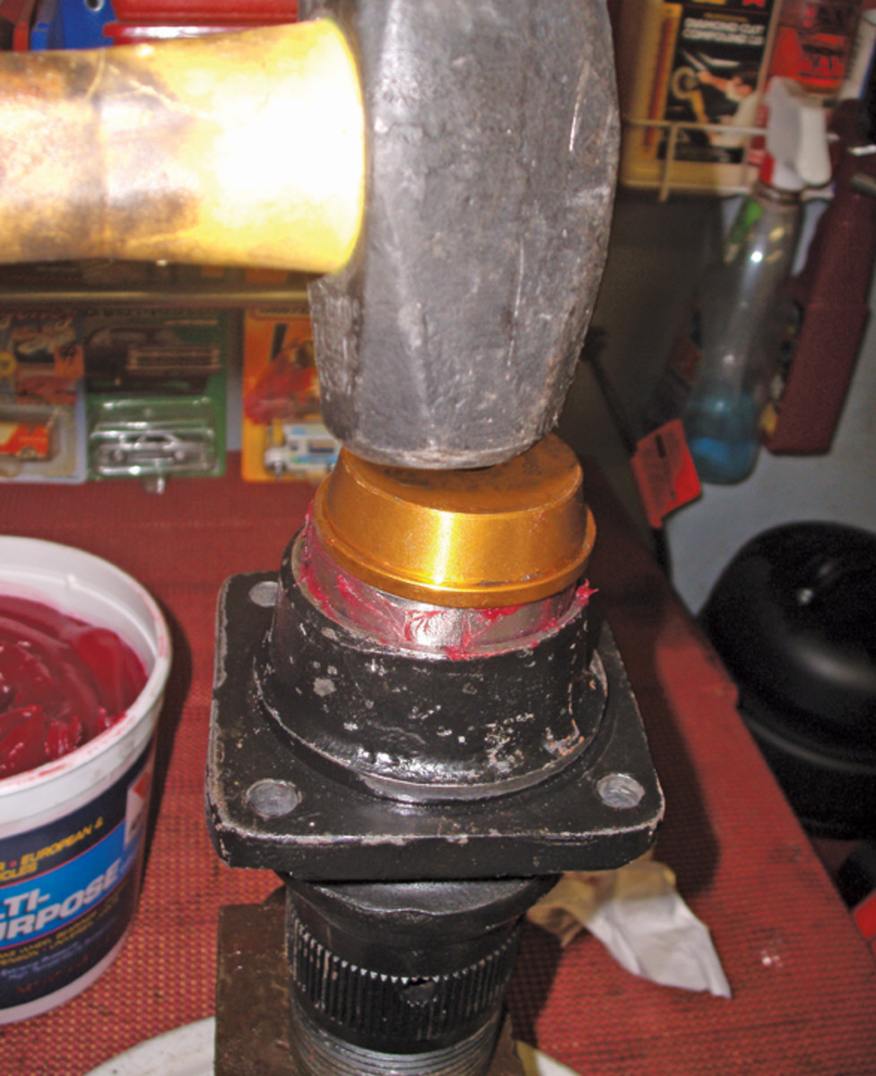 """Often, a hammer or mallet pounding against the proper-size aluminum collar from a bearing driver set will do a very good job of installing a bearing or race. """"Tap, tap, tap""""-type hammer blows will evenly """"walk"""" a race into place."""