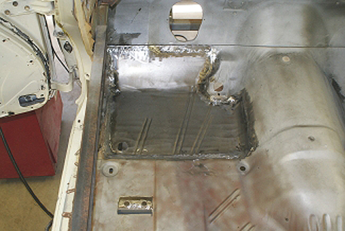 The floor pan section is completely welded in place with the welds ground down. Four steps of sanding will further even the weld. When primed and painted, it will be impossible to determine that the floors were replaced.