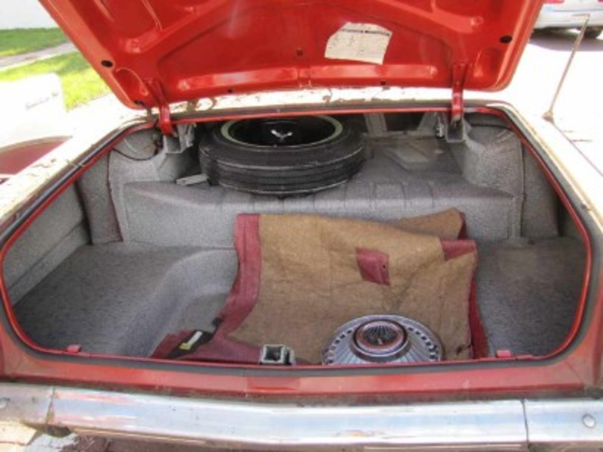 The front carpet andone of the never-installed wheelcovers were in the car's trunk, along with the original spare. The other four tires are also original.
