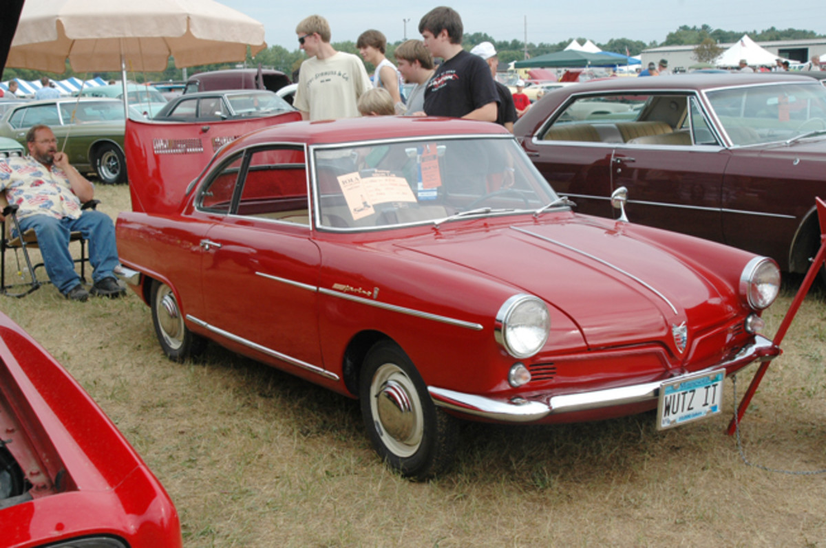 """Ray Otto was answering the """"WUTZIT"""" question posed by the license plates of his 1960 NSU Sport Prinz all afternoon. The German coupe was designed by Berton of Italy and is powered by a two-cylinder, air-cooled engine of 30 hp."""