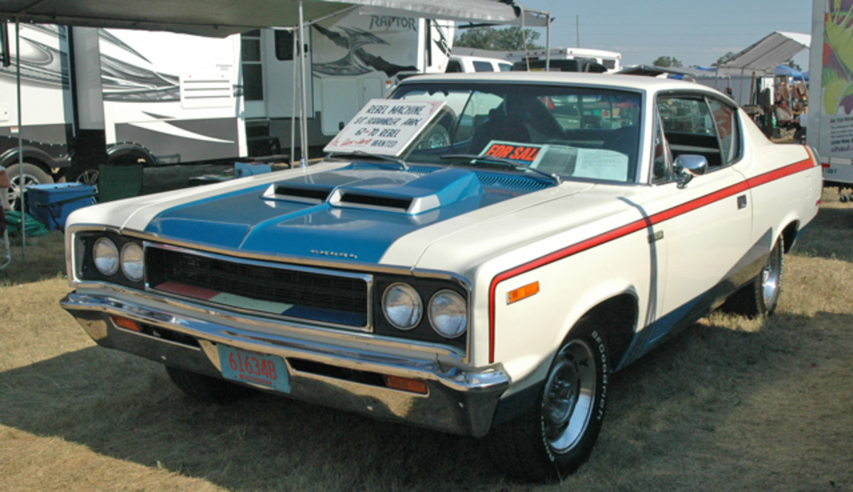 A largely original 1970 AMC Rebel Machine with the original stripes, engine, transmission, interior and most of its paint was priced at $26,800.