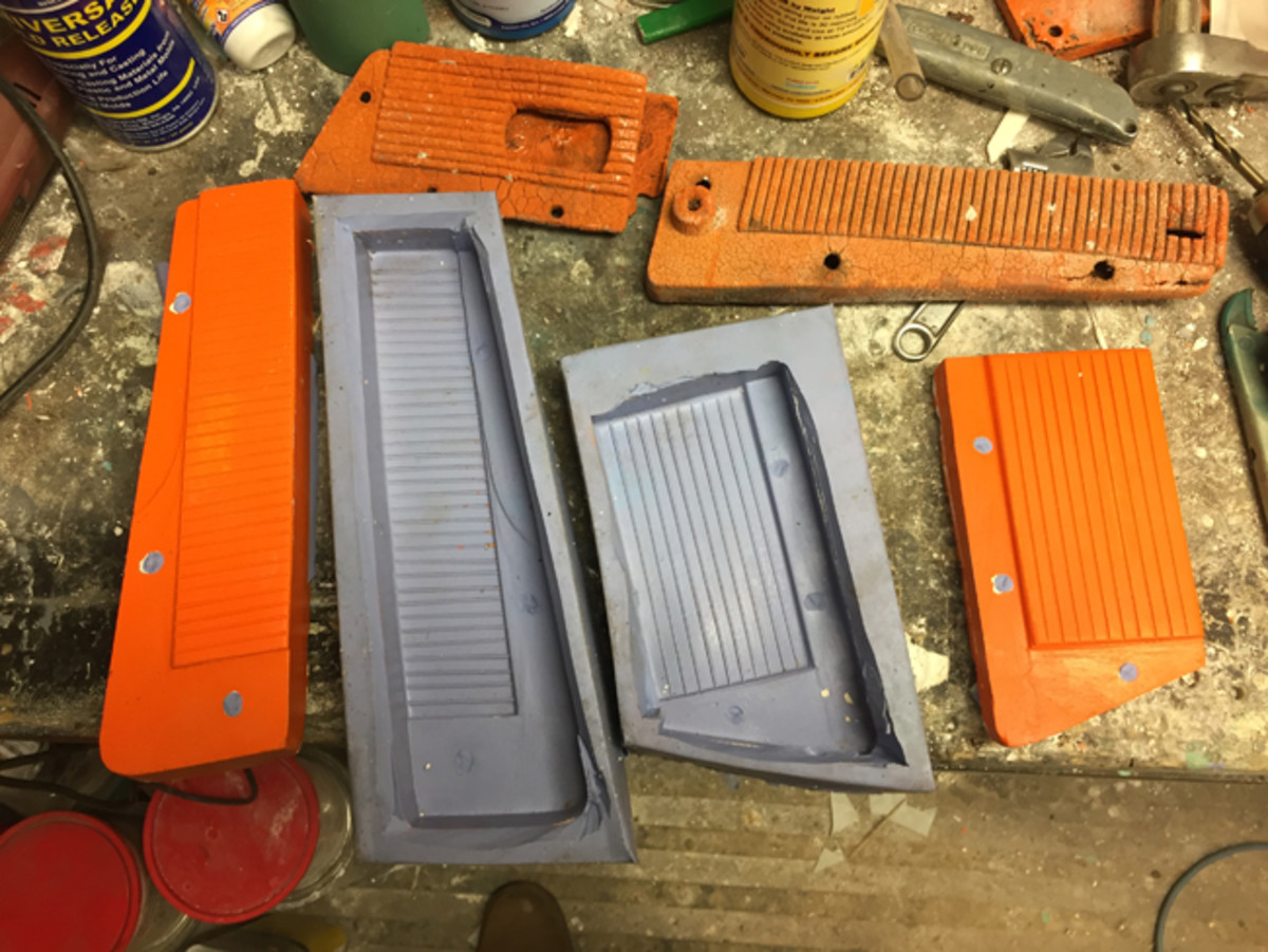 The back sides of the original pedals (top), the plaster molds (center) and the silicone molds (far left and right).