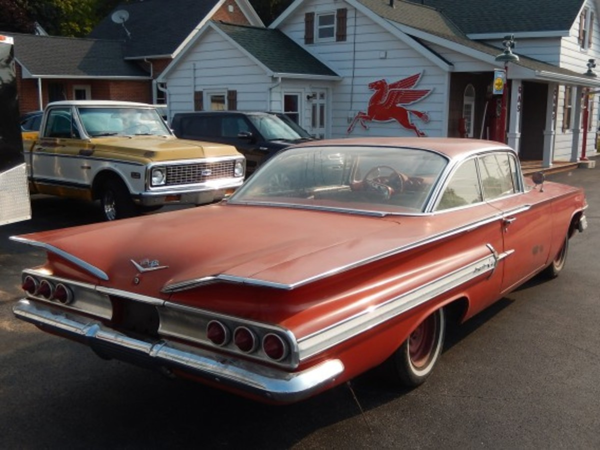 A rear view of the 1960 Impala with its trademark triple tail lamps on each side. When replacing the decades-old rubber, Fisette discovered the rear wheels were one inch wider than the front wheels, all of which appear to be original.