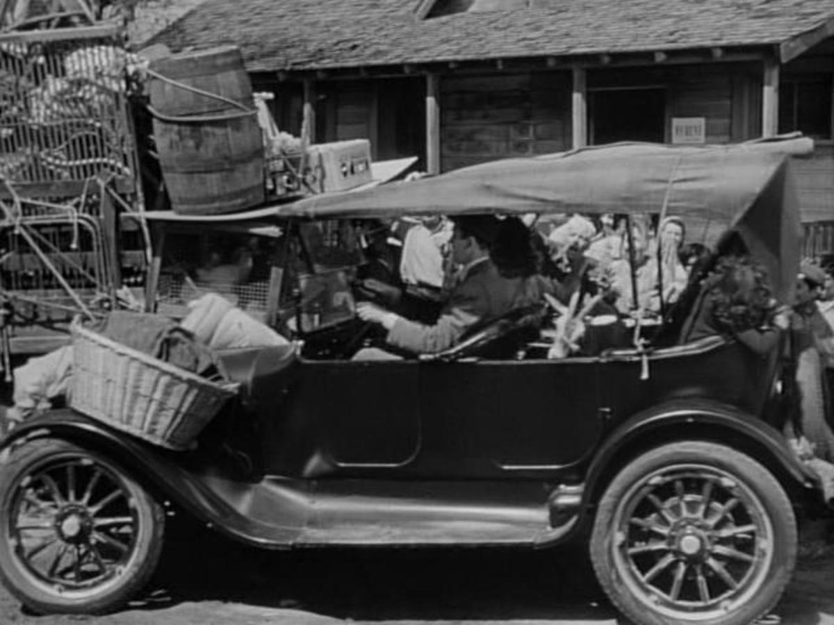 The 1919 Dodge Brothers touring and Jimmy Stewart's character, George Bailey, during happier moments in 'It's a Wonderful Life.'
