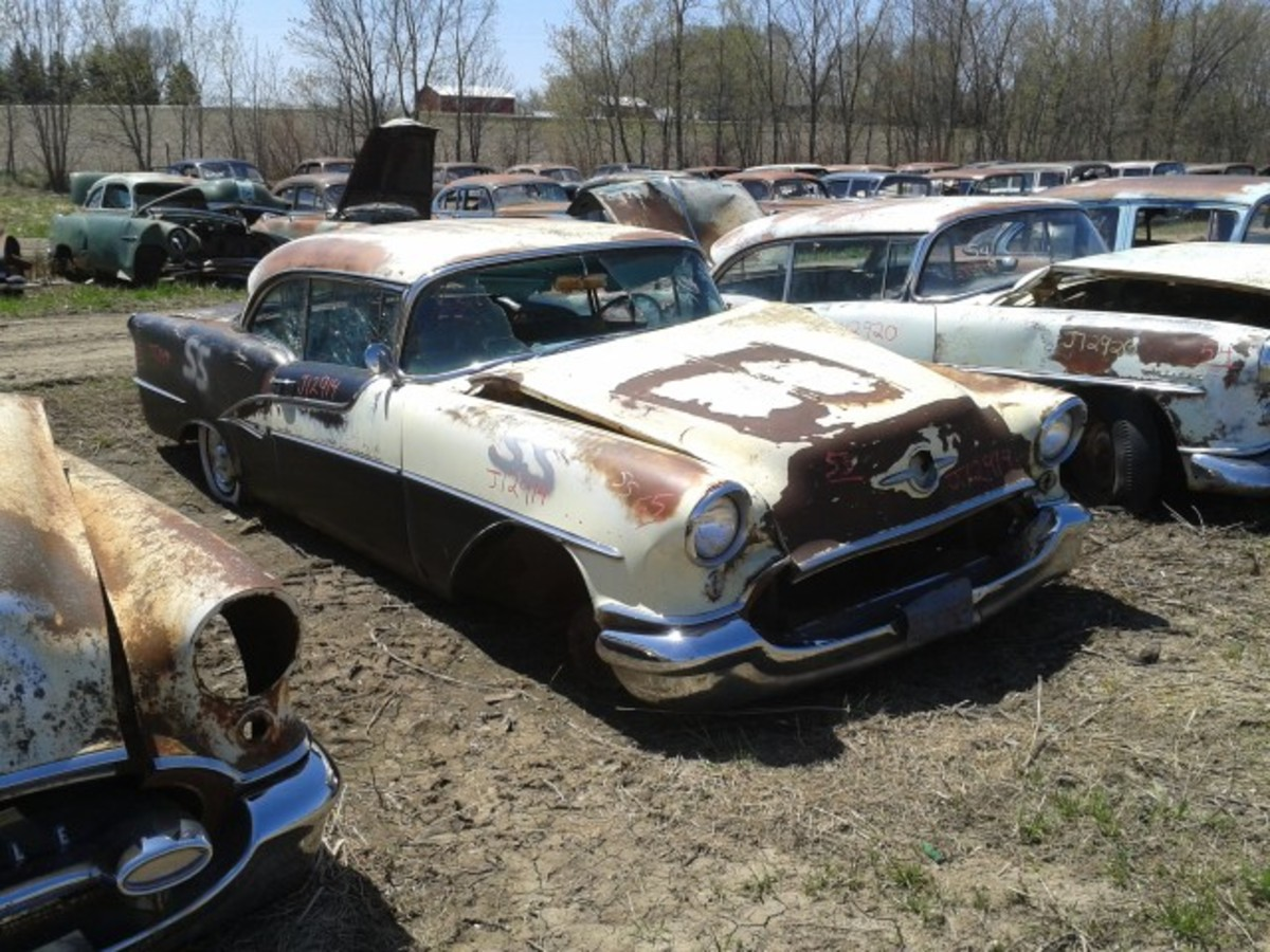 It makes my heart sink a little bit to see a burnt Rocket out to pasture, but this example's parts should keep another 1955 Oldsmobile Ninety-Eight Holiday coupe or two burning up byways.