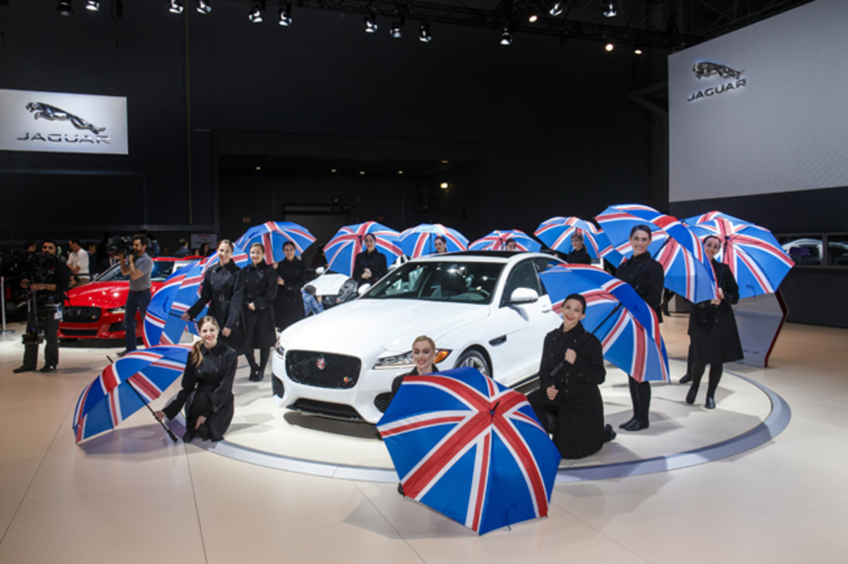 "Jaguar's ""80th Year of the Cat"" commemoration at the 2015 New York auto show witnessed a Union Jack umbrella ballet by the Wagner College Dancers, enhancing the unveiling of a more spacious and aluminum-intensive XF midsize sedan where the rear-drive models shed 132 pounds and all-wheel-drive versions are 265 pounds lighter; optimal 50-50 weight distribution is another dividend of this diet."