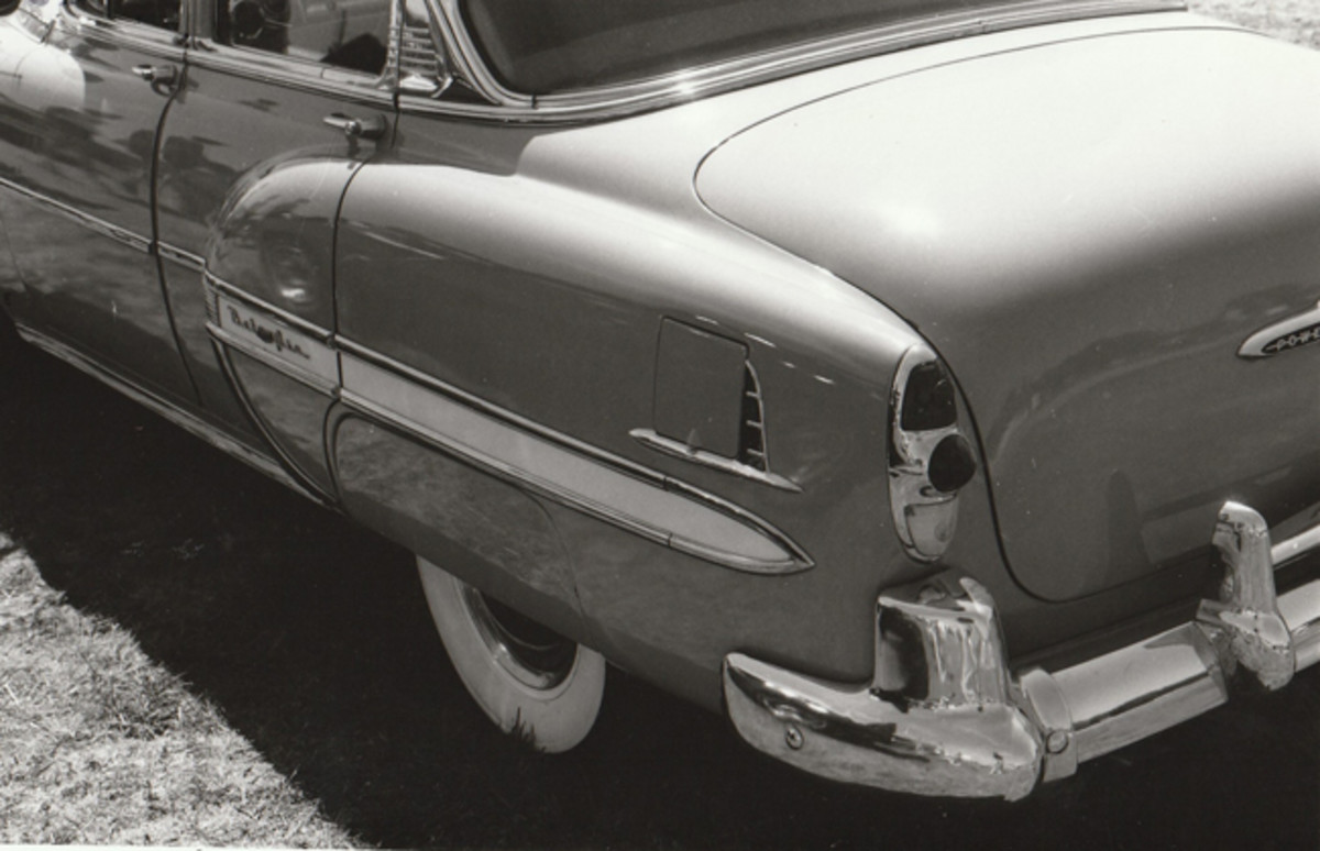 Bel Air close-up shows '53 style bumper and taillights, plus factory gas door guard.