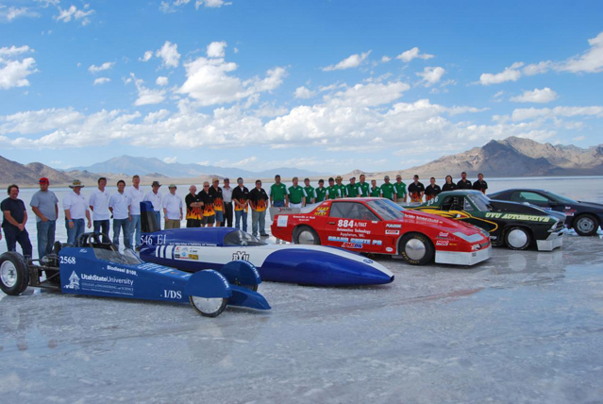 The college teams lined up with their cars on the Bonneville Salt Flats for a group photo.