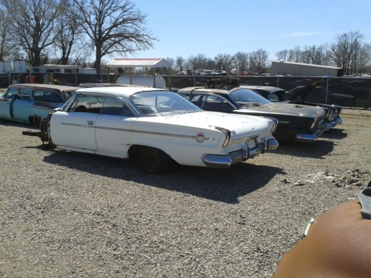 Three, count 'em, three 1962 Chrysler 300 models. The white car in the foreground is a 1962 300-H letter car, and it's solid.