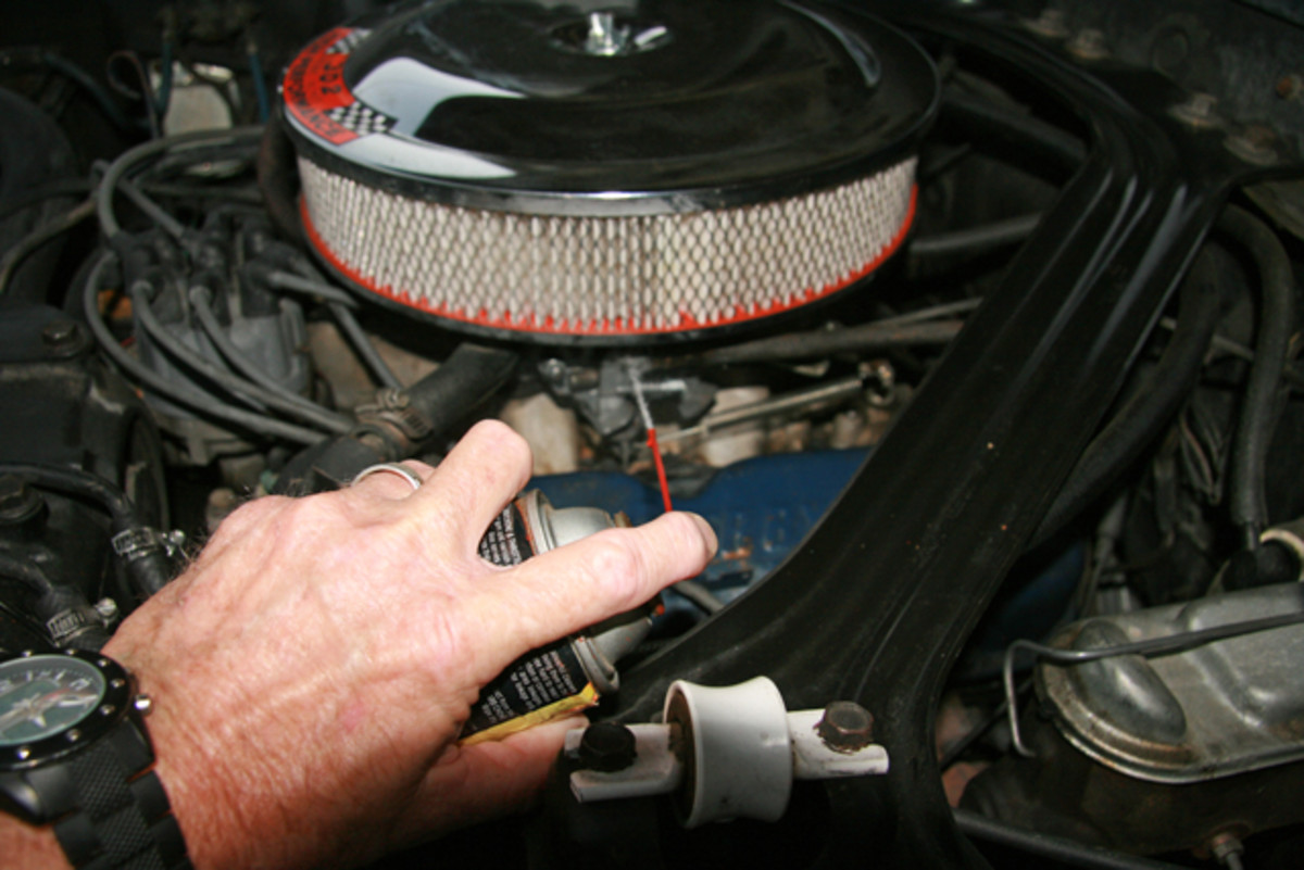 Vacuum leaks can be located with spray carburetor cleaner or a can of WD-40. If the area is obstructed by linkage or hoses, use an extension nozzle to pinpoint the area of the vacuum leak. If the engine speeds up when an area is sprayed, you are close to finding the leak.