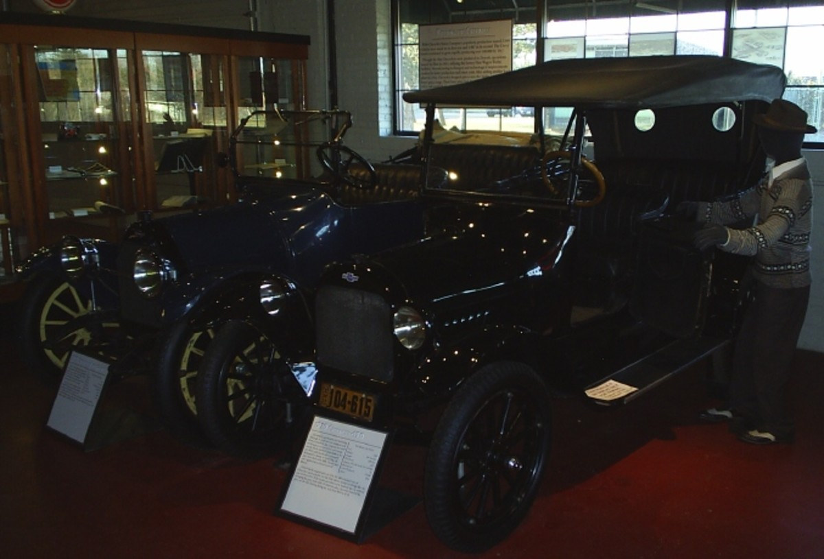 Wind-in-your-hair 1915 and 1920 Chevrolet models part of the Chevrolet centennial display.