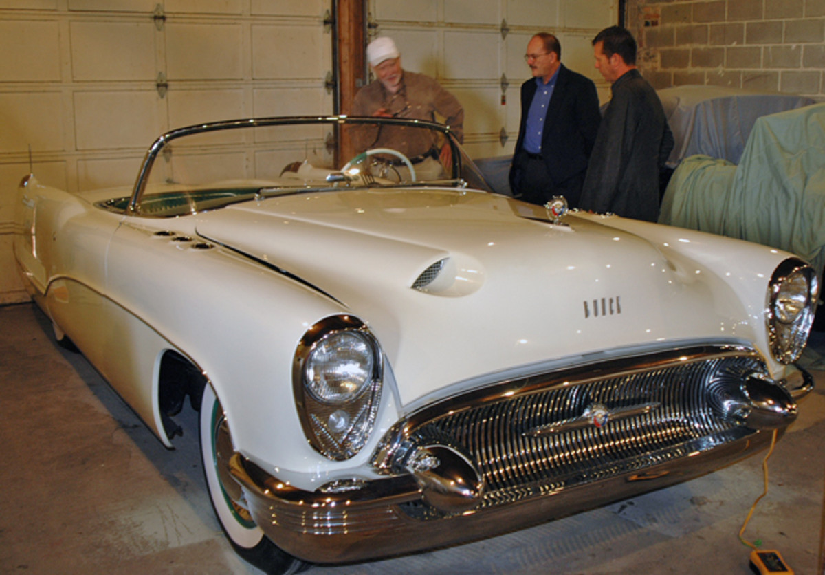 The trio looks on the 1953 Buick Wildcat concept car owned by Joe Bortz. The fiberglass-bodied car uses a shortened version of the chassis used by production 1953 Buicks.