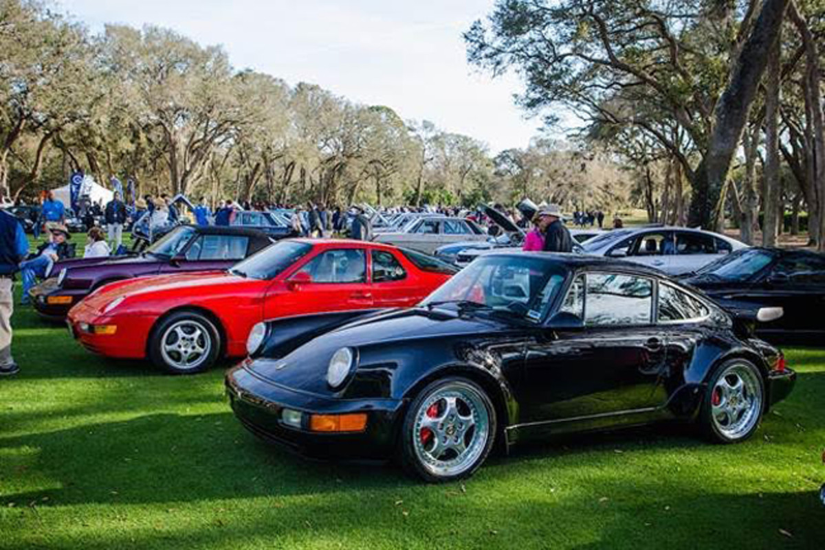 Cars gather on the 10th and 18th fairways of The Golf Club of Amelia Island for Cars & Coffee at the Concours