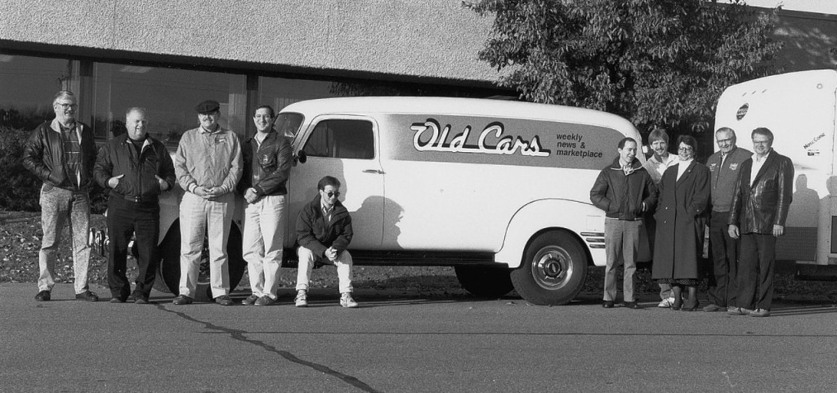 "James T. Lenzke (third from left) with the Old Cars Weekly staff and ""Buck,"" the 1954 Chevy panel truck built by Kenny Buttolph (second from left)."