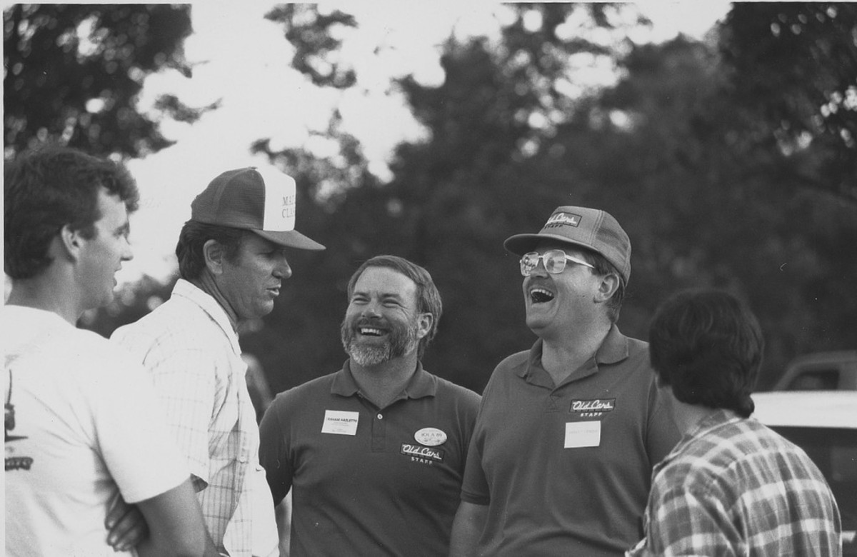 Lenzke (second from right) having a laugh with Gary Esse of Madison Classics (second from left) at a past Iola Car Show.