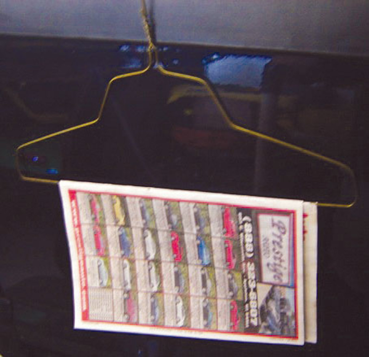 I constantly pick up the free cars-for-sale shoppers from the gas station. I pull the two staples out of the spine, drape the pages over a clothes hanger and have an unlimited supply of free shop rags. The pages work well for soaking up oil.