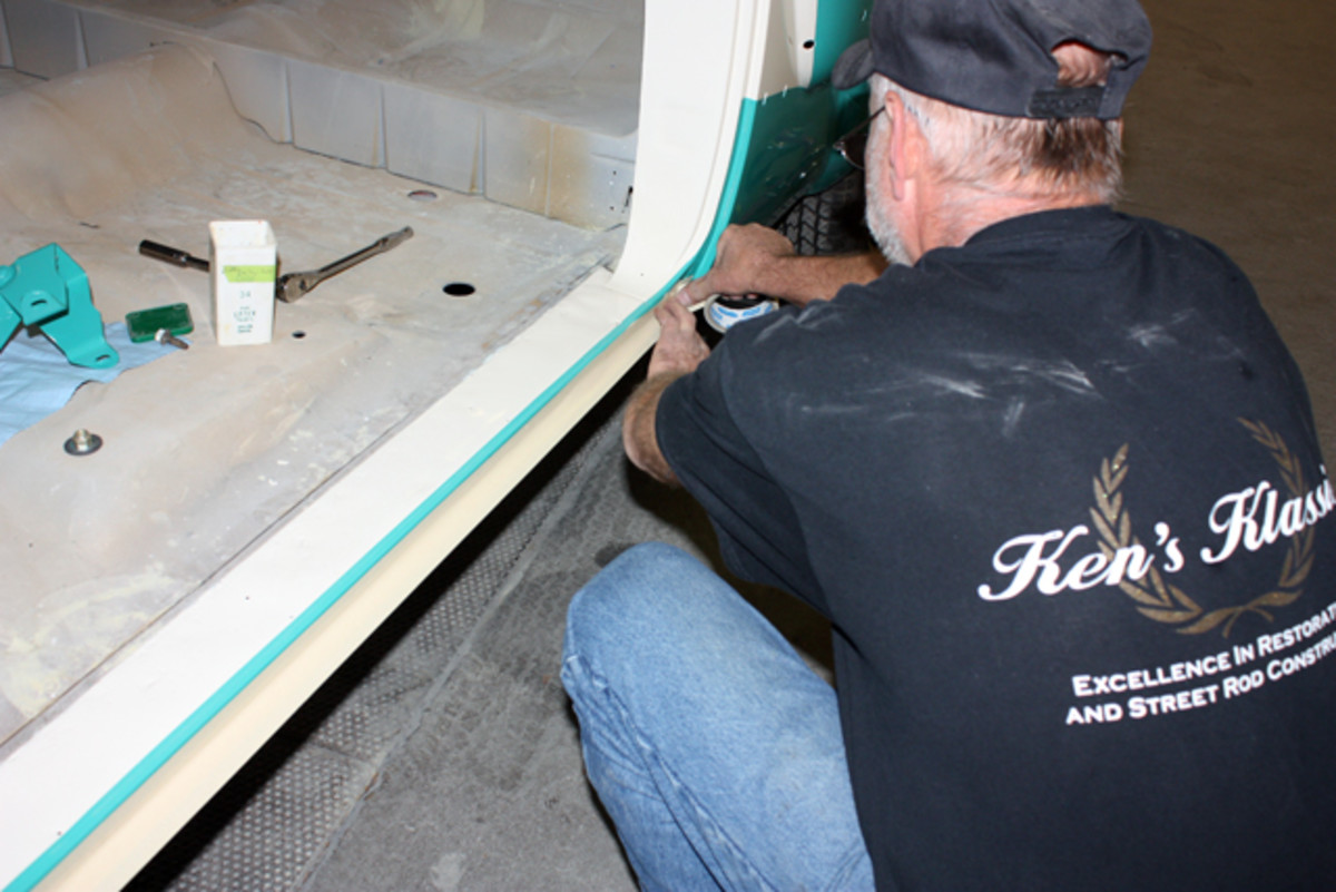 The door jamb and bottom of the door opening are both protected with masking tape before any fitting takes place.