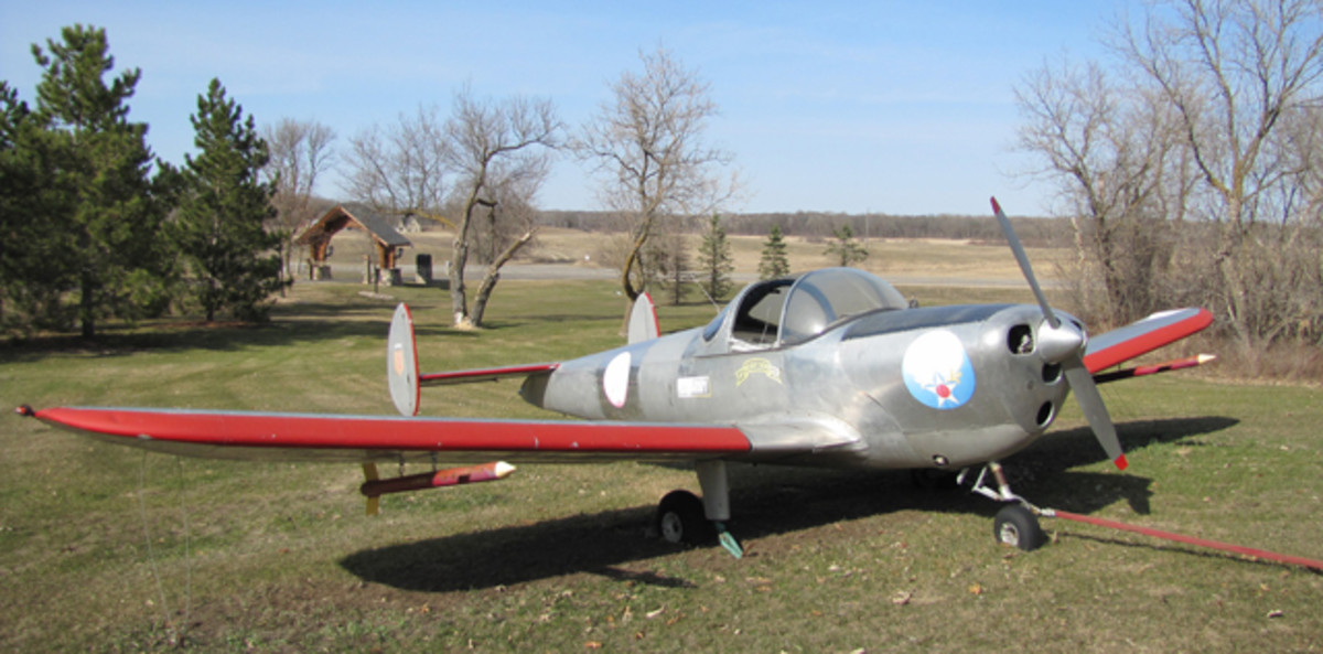 Lot #87V: A 1946 Air Coupe Airplane. It has not run recently. Been lawn art. It is loose and is a 4 cylinder continental engine. It was a military plane. It has seats inside. 2 place Air Coupe. Aluminum Body.