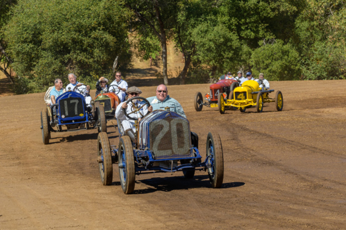 """The spirited race cars with their drivers and """"mechanicians"""" at turn one of the dirt track. (Ron Kimball Studios image)"""