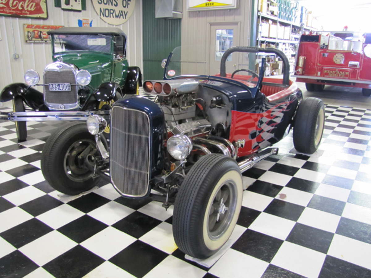 Lot #60V: 1932 Ford Vintage Hot Rod. 3830423. It has a 32 Grill and 1963 327 Motor with 2 4bbl Carbs. Eldelbrock Valve covers. Hydromatic powerglide transmission. Stall Converter. 1956 Chevrolet Rear End. American Racing Wheels from the 1960's. Front Disc Brakes. Fiberglass 1932 Ford Grill. Interior is original from the 1960's.