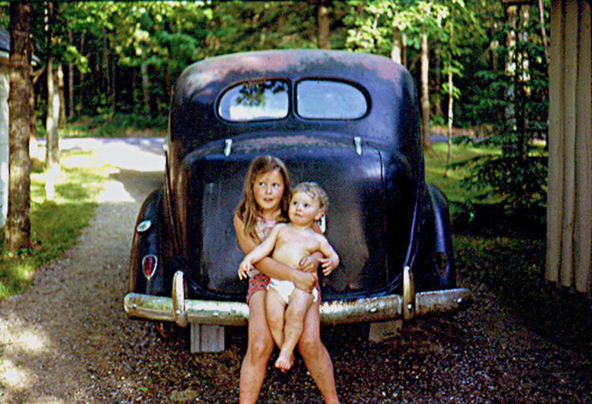 This picture of my sister and me was taken sometime in 1973 in the driveway of my family's cottage in the Northwoods of Wisconsin. Showing my pasty white baby physique in times before any thoughts of sunscreen.From what I was told the Plymouth's engine gave up the ghost in the early 60s and was parked in that spot until sometime in the early 90s. I gained many a bruise from that car seeing the tree swing hung just to the left of it beside the garage.