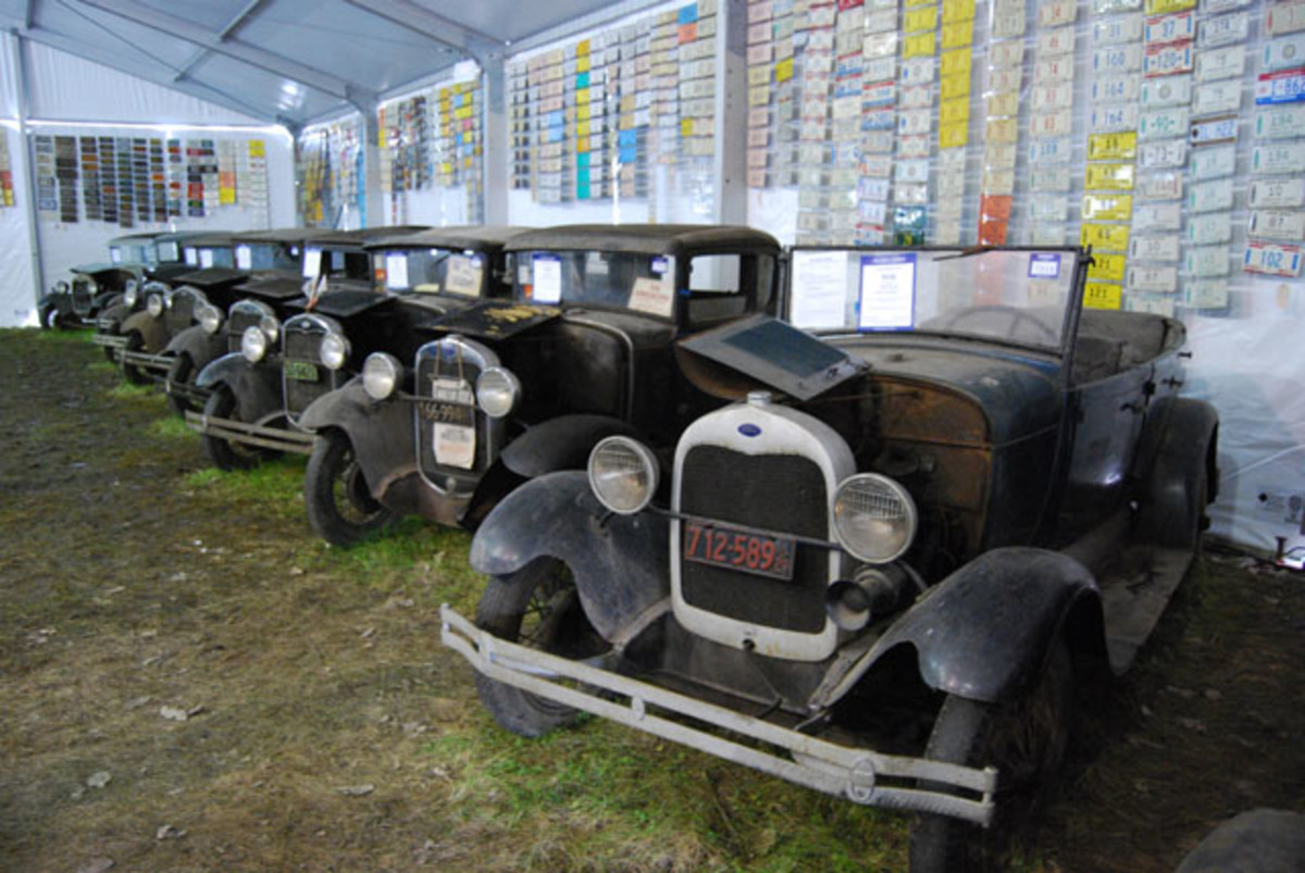 This was not all of the Model As, but it was the better ones. Each license plate you see behind them was removed from the rafters and mounted on plywood panels by the hardworking Auctions America staff.