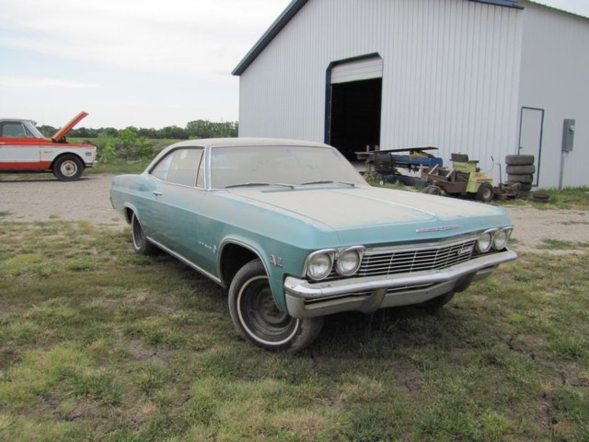 This 1965 Impala carries a 396-cid V-8 and looks like it's been stored inside.