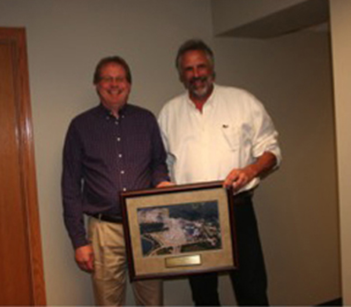 Larry Fechter presented Waldo Riesterer with a framed picture of Iola '15 for his years of sponsorship at Iola Car Show & Swap Meet.