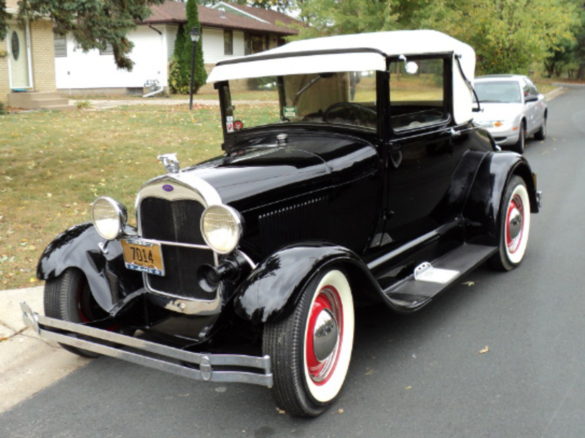 A 1929 Ford Model A has some old school hot rod modifications, along with a stylish white top.